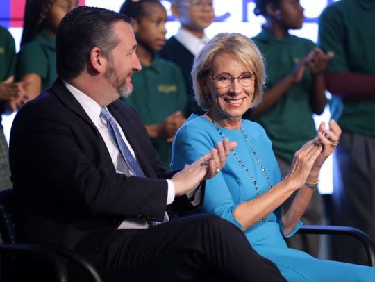 Betsy DeVos and Sen. Ted Cruz (R-TX) participate in