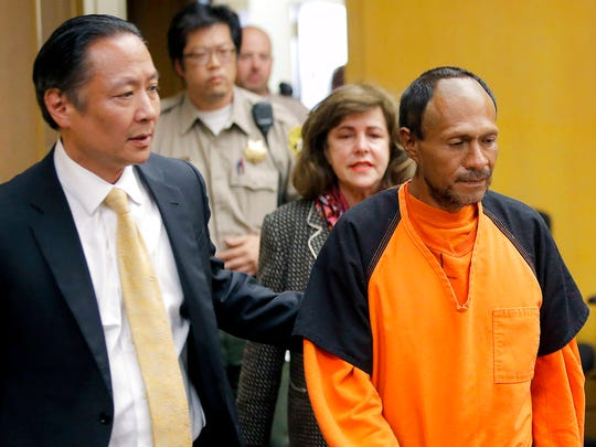 In this July 7, 2015 file photo, Jose Ines Garcia Zarate, right, is led into the courtroom by San Francisco Public Defender Jeff Adachi, left, and Assistant District Attorney Diana Garciaor, center, for his arraignment at the Hall of Justice in San Francisco.