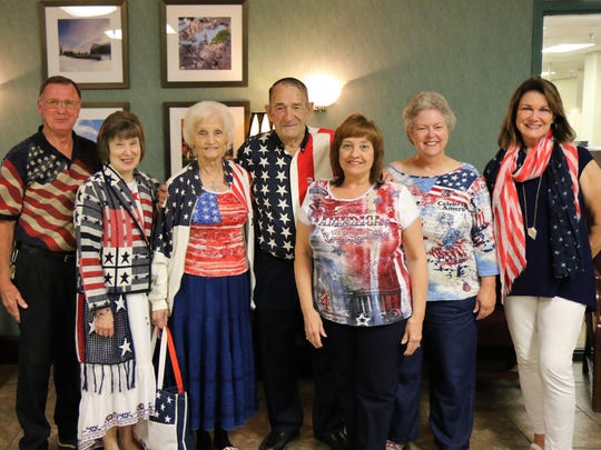 Jerry Howell, Diane Howell, Pat Briley, Jack Briley, Teressa McDonald, Kathy Tillman and Marcia Moss show their patriotic spirit by dressing for the occasion during the Hub City Harmony, a patriotic themed performance, Friday, May 25, 2018, on the campus of Union University in Jackson.