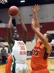 FAMU's Kenyatta Colvin shoots over Bradenton Christian's Justin Aracena during the Rattlers' 61-44 loss in the 2A state semifinals on Tuesday in Lakeland.