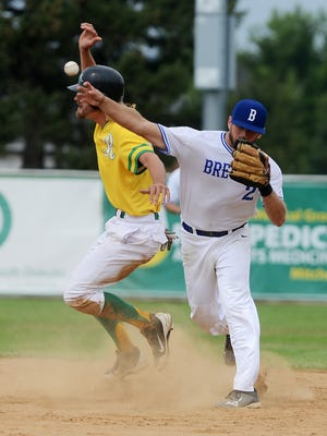 The Sioux Falls Brewers' Ian Strum attempts a double play as the Renner Monarchs' Chaz Palmer touches second base in the State A amateur baseball championship at Cadwell Park in Mitchell, Aug 16, 2015. The Monarchs beat the Brewers 1-0 in 10 innings.