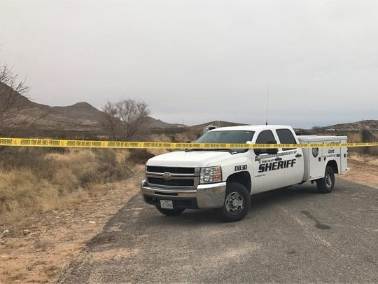 El Paso County Sheriff's Office crime-scene investigators work at the scene of a homicide on Stagecoach Drive near Hueco Tanks.