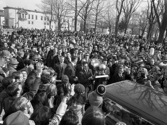 The 1967-68 Manitowoc boys basketball team brings home the trophy during a rally at the Mikadow Theater in Manitowoc after winning the WIAA state championship. An estimated 5,000 showed up.