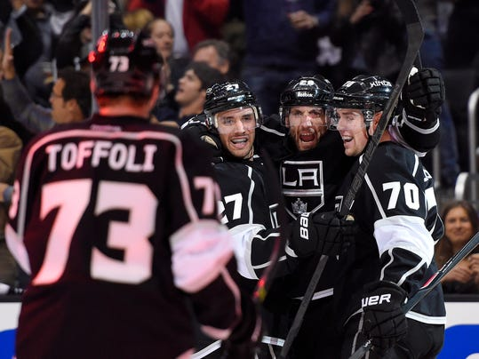 Los Angeles Kings center Jarret Stoll, second from right, celebrates his goal with center Tyler Toffoli, left, defenseman Alec Martinez, second from left, and left wing Tanner Pearson during the second period in Game 3 of an NHL hockey first-round playoff series against the San Jose Sharks, Tuesday, April 22, 2014, in Los Angeles. (AP Photo/Mark J. Terrill)