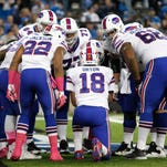 Buffalo Bills quarterback Kyle Orton (18) calls a play in the huddle  against the Detroit Lions.