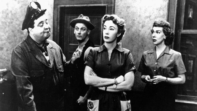 """A scene from the classic television show """"The Honeymooners."""" Pictured are, from left: Jackie Gleason as Ralph Kramden, Art Carney as Ed Norton, Audrey Meadows as Alice Kramden and Joyce Randolph as Trixie Norton."""