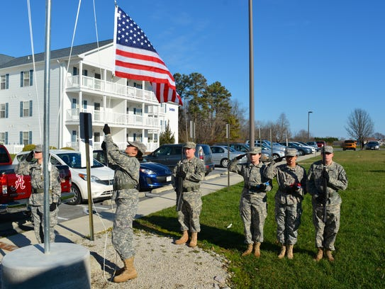 The Cape Henlopen High School JROTC raises an American