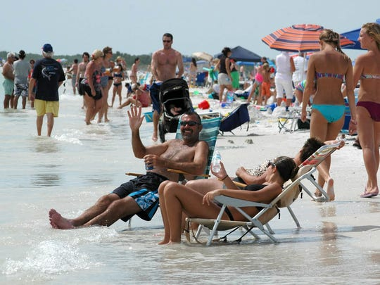 In this file photo, Marco Island visitors celebrated Independence Day with beach picnics and fireworks at Residents' Beach on July 4th, with happy throngs enjoying perfect weather.