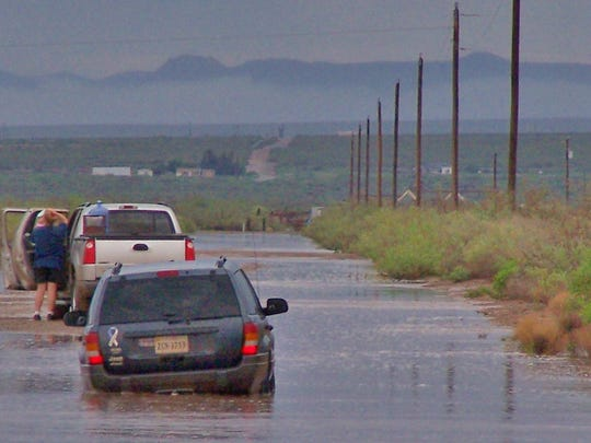 In this file photo, county residents are left stranded in the middle of a dangerous flooded public road near Escondido Gardens and Acres.