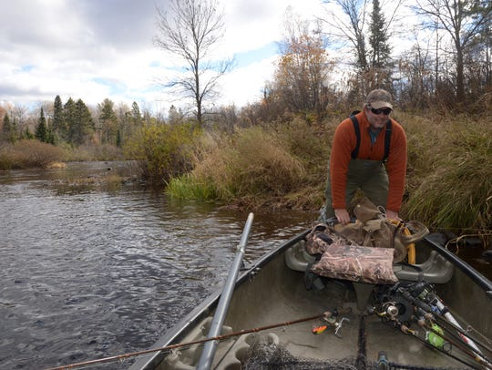 Guide and outfitter John Maier launches his rowboat