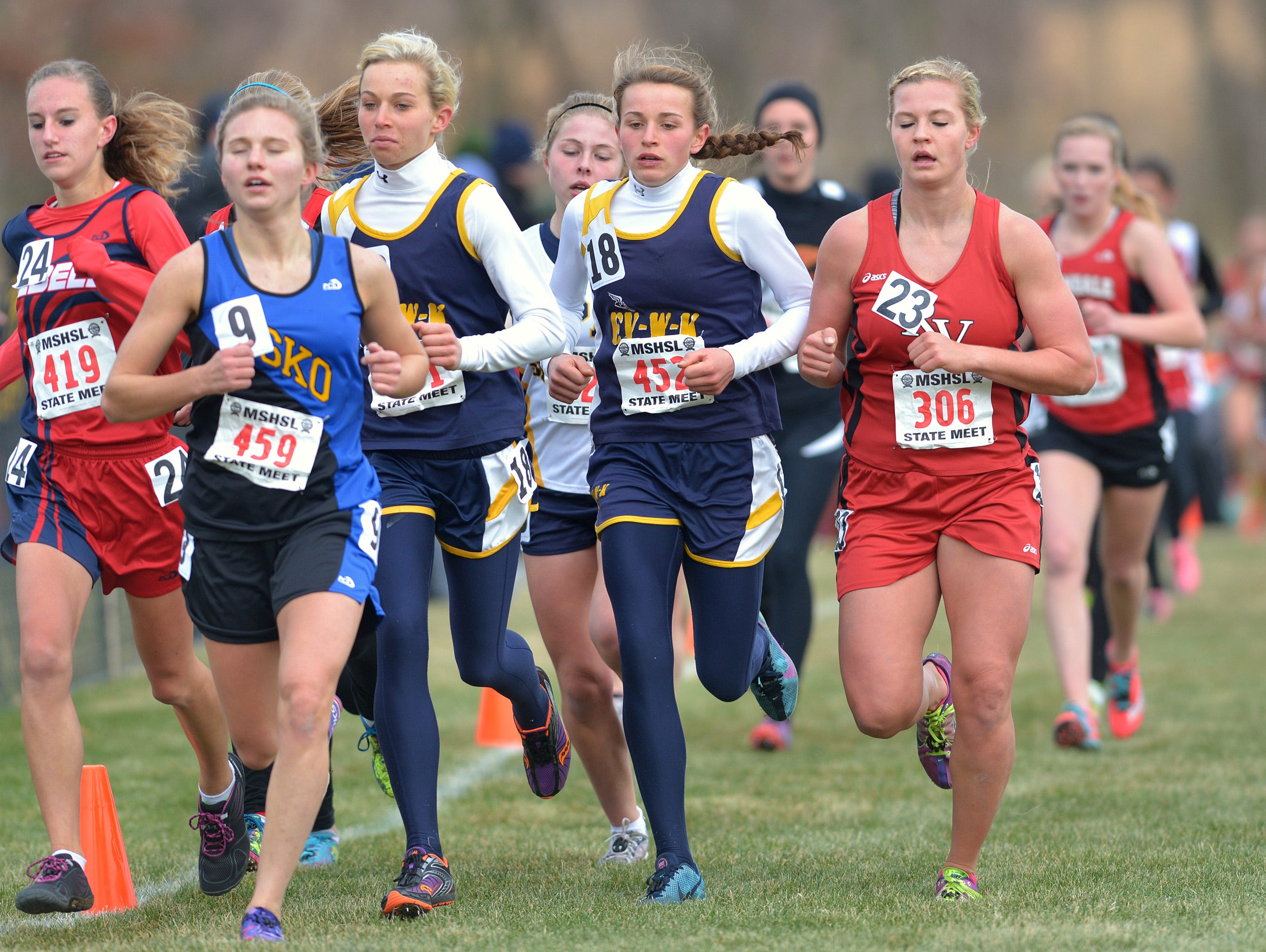 Eden Valley-Watkins/Kimball's Anna Donnay (452) runs alongside her sister Emily (451) at the state meet last season in Northfield. She finished third a year ago and is back at state again this season.
