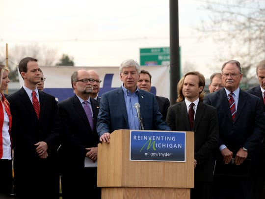 Michigan Governor Rick Snyder speaks durin a bill signing ceremony for the $1.2 billion road funding bill Tuesday, November 10, 2015 at the Michigan Infrastructure and Transportation Association in surburban Lansing. The plan passed the Legislature late on November 3.