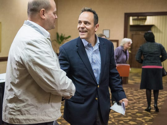 Kentucky Gov.-elect Matt Bevin stops to shake hands with his Simpson County campaign coordinator Robert Taylor, left, after speaking at the Republican State Central Committee Meeting at the Triple Crown Pavilion conference center in Louisville.