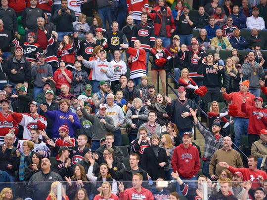 St. Cloud State supporters cheer for the Huskies after right wing Jacob Benson's goal ties the game during the first period of the NCAA Division 1 West Regional semifinal game Saturday, March 26, at the Xcel Energy Center in St. Paul. Ferris State led St. Cloud State 2-1 at the end of the first period.