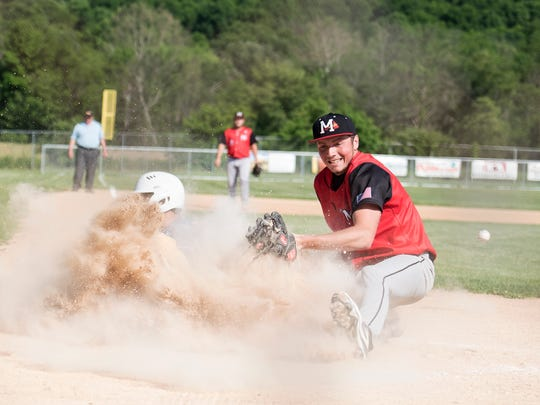 Southern Fulton's Logan Beatty slides into home plate as Riley Christner of Meyersdale tries to tag him out during the District 5 Championship on Wednesday, June 1, 2015 in Everett, Pa. Beatty was safe.