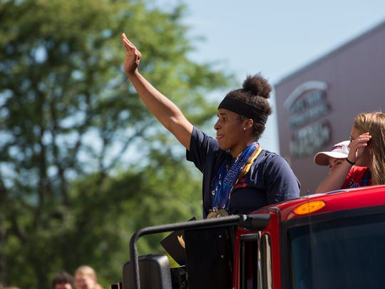 Binghamton High School track athlete Alexis Daniels waves to the crowd during a ceremony celebrating the track and softball team's state championships at City Hall on Tuesday evening.