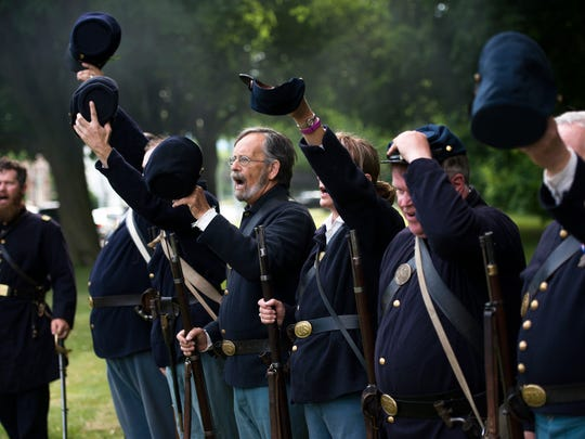 Civil War re-enactors cry out during an unveiling ceremony in June for a historical marker honoring the 137th New York Volunteer Infantry.