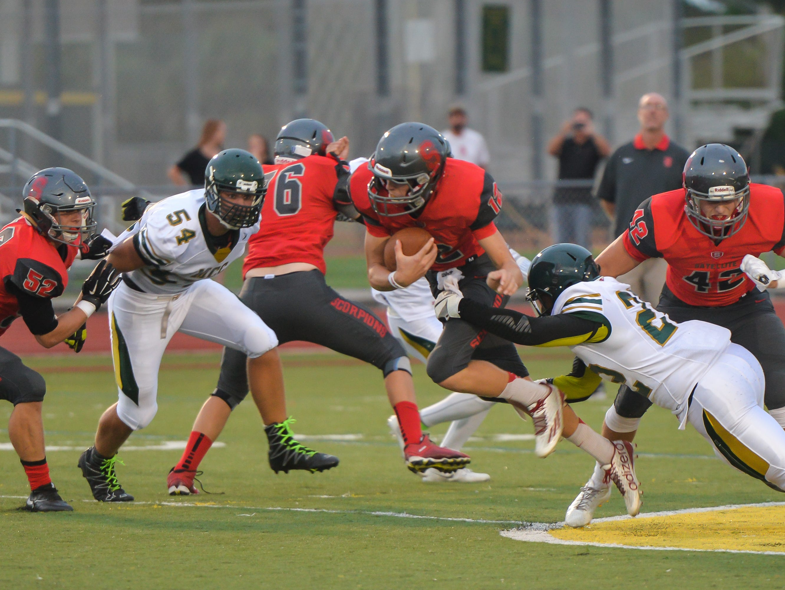 Satellite's Noah Mumme carries the ball during the game at Melbourne Central Catholic High School.
