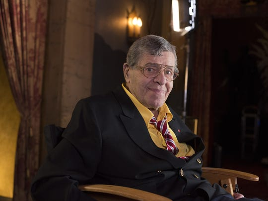 In this April 12, 2014, file photo, actor and comedian Jerry Lewis poses during an interview at TCL Chinese Theatre in Los Angeles.