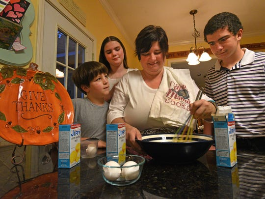 Aimee Bowlin makes her traditional Thanksgiving cornbread with a little help from her kids.