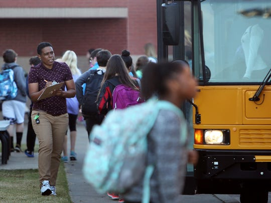 Students arrive at Houston Middle School. In the three years since the district started, K-5 enrollment has increased 544 students. Middle school enrollment jumped from 863 to 1,134 in the same period.