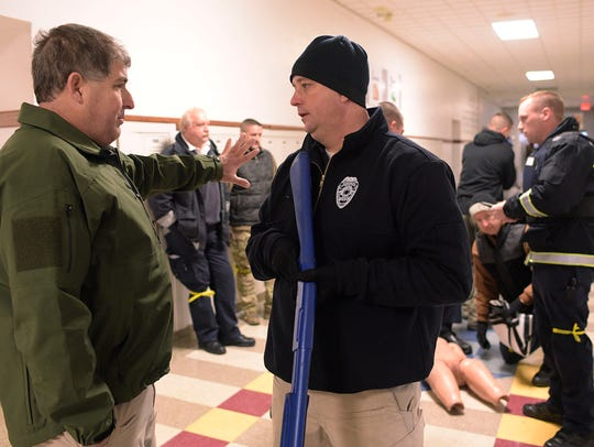 "Farmington Hills Fire Department EMS coordinator Jim Etzin (left), here talking with Farmington Police Sgt. Shane Walsh during an active-shooter training program, said fixing the school shooting epidemic is going to take an ""all hands on deck"" approach."