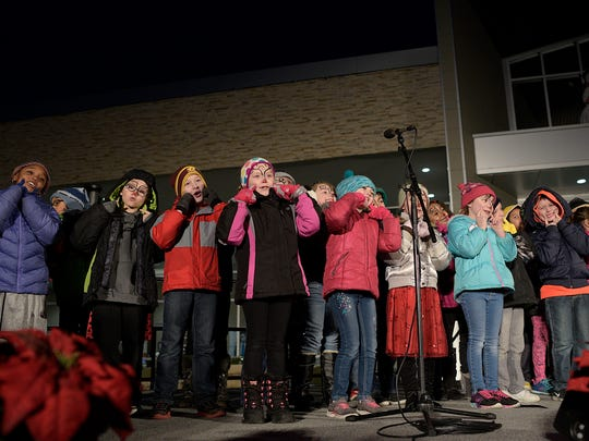 Edison Elementary second-graders and third-graders perform on the stage.