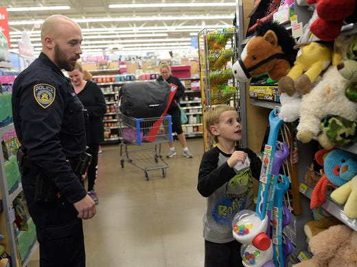Kids heroes team up for some christmas shopping fun - Garden city michigan police department ...