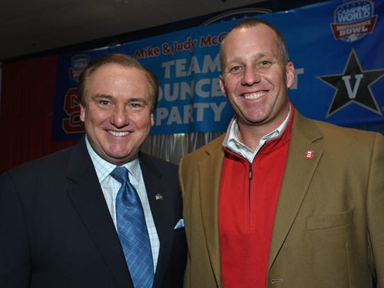 North Carolina State head coach Dave Doeren and Fox sports personality Tim Brando at the Independence Bowl team announcement party.