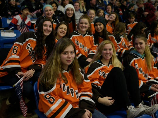 Saturday's women's hockey game between the U.S. and Canada enabled teams such as this one from Compuware to hang out and cheer together.