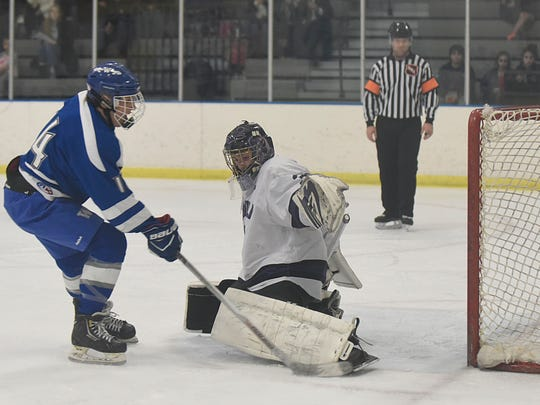 Bloomfield Hills goalie Jacob Bayer keeps his team in the game with this great save on a second-period penalty shot by Western's Rees Dobbs.