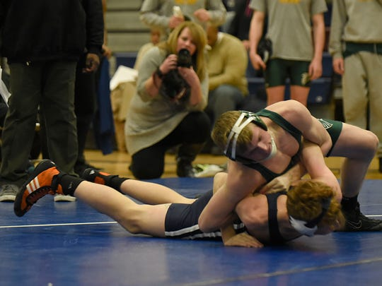 Groves junior Micah Mydloski (top) is a first-time state qualifier who finished fourth at both the district and regional rounds of the Division 1 state tournament.