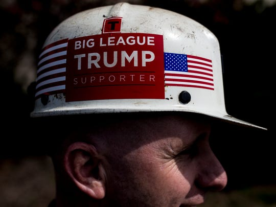 Paul Miracle, a Kentucky coal miner, waits in line