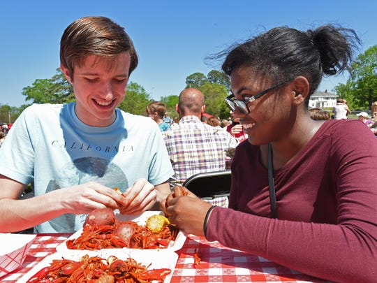Tifphany McClinton and Caleb Riser enjoy the mudbugs at Crawfest 2017.