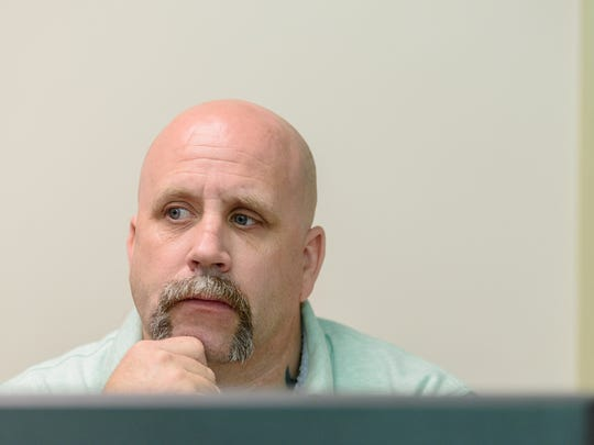 Student worker Jeremy Wells, 46, looks over his monitor for students in distress as he works the computer help desk in the library at Jefferson County Technical College. April 6, 2017
