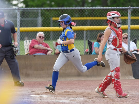 Maysville's Kaylie Farmer scores against Dover.