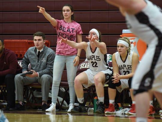 Mackenzie Harbort (pink shirt) missed her entire senior
