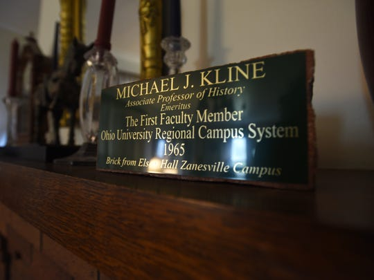 A brick marking Michael Kline's career at Ohio University's Zanesville Campus on the mantle of Kline's home.