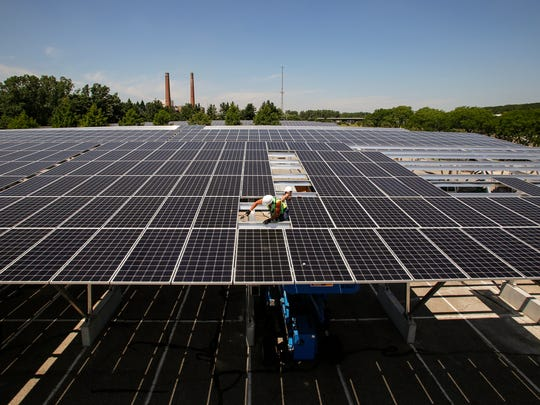 Michigan State University will pursue a 10-year power purchase agreement for the construction of a 100-acre solar array in the Agriculture District. The panels will be similar to those above the parking bays on the southern part of campus, like these shown in Lot 89 in July 2017.
