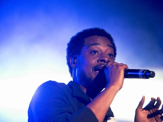Headliner Danny Brown performs for the large crowd during Adidas's EQT event at the Russell Industrial Center Aug. 19, 2017.
