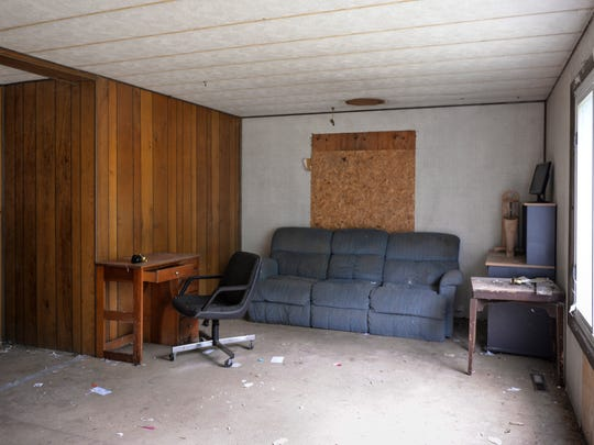 A look at the living room at the home on Durfee Road in Eaton Rapids last fall before new owners Trixie and John Tanner bought and remodeled it.  Eaton County will auction off 27 foreclosed properties Sept. 6.