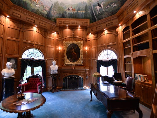 The library of a 10,116 square foot home at 5925 Old