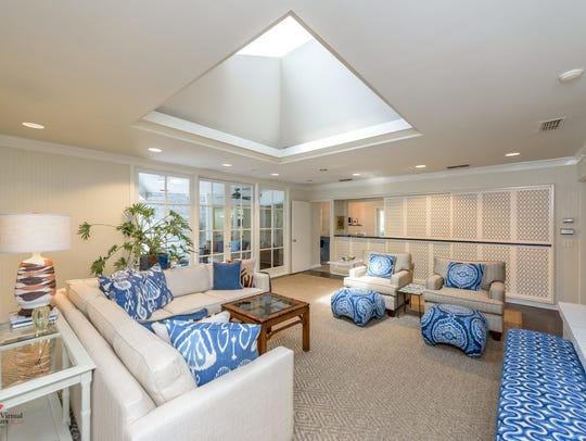 The home features an open floor plan with several living