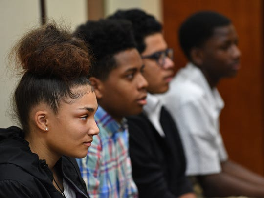 Jurors listen to the evidence during a trial at Caddo