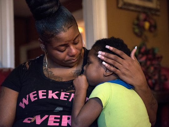 Chalisa DeGraffreed shares a moment with her 6-year-old