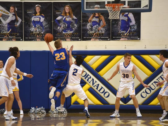 Maysville's Connor Sidwell puts up a shot against West