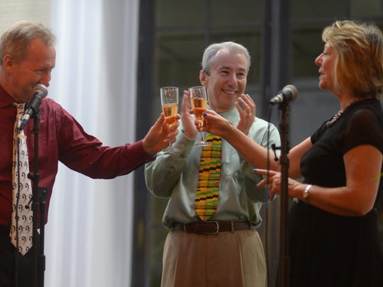 Heifetz International Music Institute's Executive Director Benjamin Roe, Founder and Artistic Director Daniel Heifetz and Mary Baldwin University President Pamela Fox make a toast celebrating the Institute's 20th anniversary in the Big Heifetz Tent on Grafton Terrace at MBU on July 8, 2016.