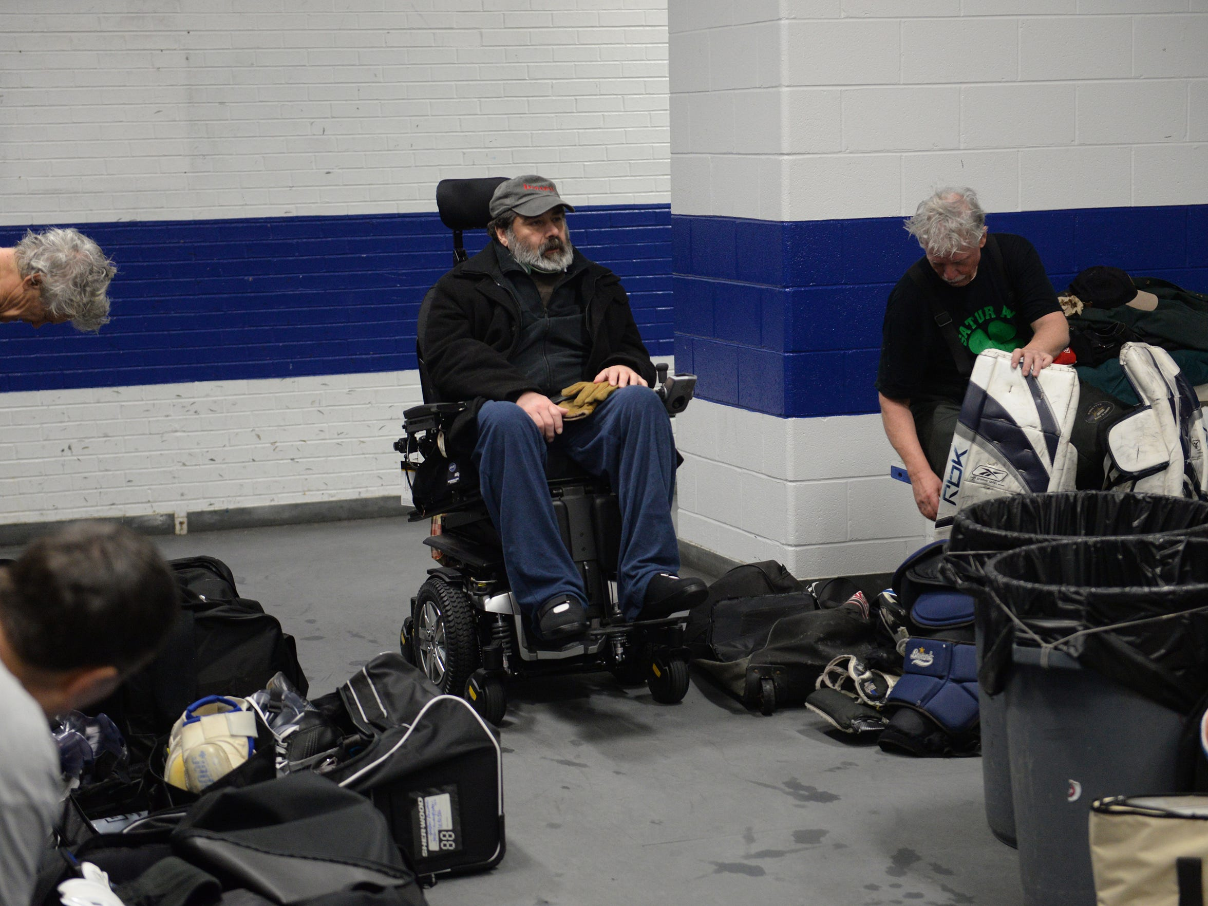 The Rev. Dimitrie Vincent visits with his hockey friends