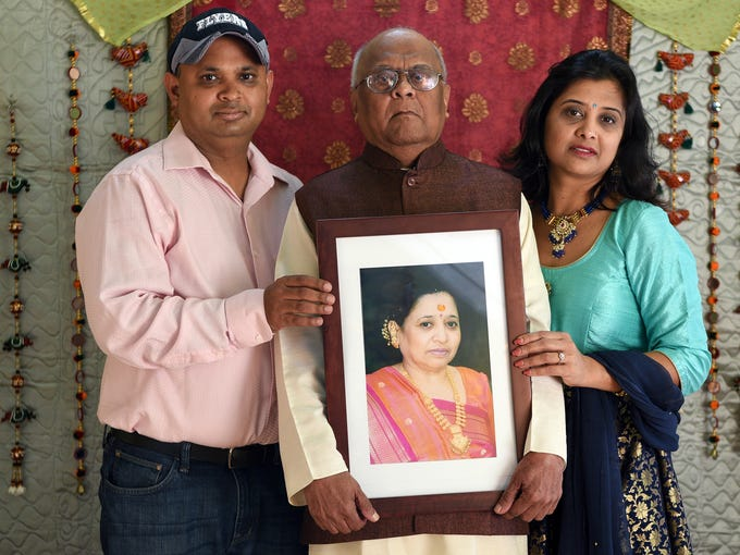 Kaushal and Neha with their father Dharnedra Shah hold
