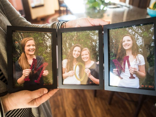 Susan Quinn holds photos of her daughters, McKenna